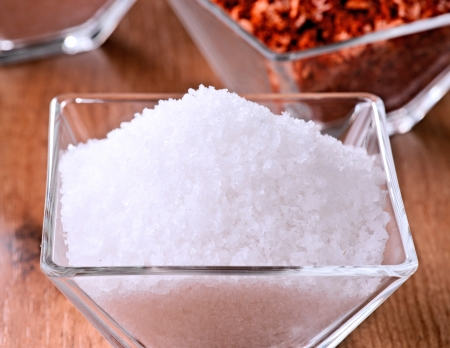 salt flakes in small glass bowl photo