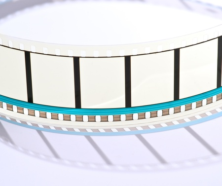 blank frames of 35mm film projected on a white background photo