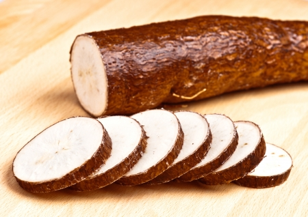 sliced yuca on wooden base Stock Photo