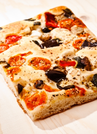 focaccia with tomatoes, olives, artichokes and vegetables, isolated on white base