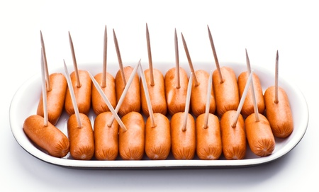 smoked sausage: cocktail sausages; punctured tray with chopsticks Stock Photo