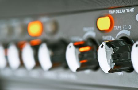 amp: controls of a guitar amplifier, making macro Stock Photo