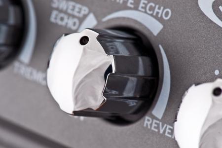 controls of a guitar amplifier, making macro Stock Photo - 15631389