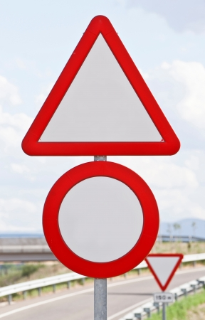 Traffic signs on a highway photo