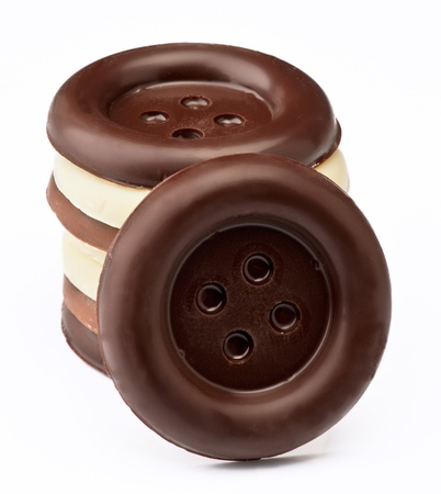 group stacked chocolate buttons, on white base Stock Photo - 16280708