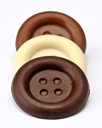 group stacked chocolate buttons, on white base Stock Photo - 16280711