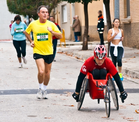 TUDELA, SPAIN - NOVEMBER 18: unidentified runners participating in the 14th race for the integration,  On november 18, 2012 in Tudela, Navarre,  Spain Editöryel