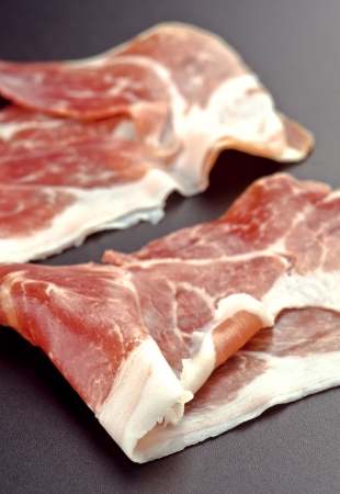 slices of Iberian ham, on dark background Stock Photo - 17549753