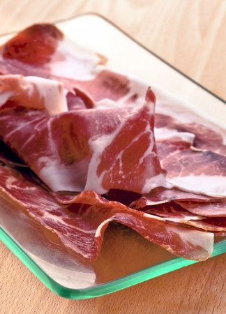 Slices of Iberian ham  of acorn  on glass tray Stock Photo - 17711078