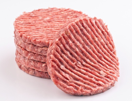 minced beef: stacked raw hamburger steaks