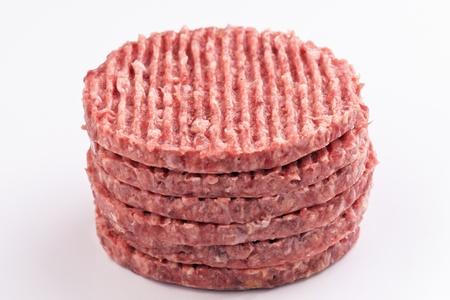stacked raw hamburger steaks photo