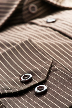 shirtsleeves: buttons, collar and sleeves of a striped shirt Stock Photo
