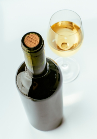 closed corks: unopened wine bottle and wine glass full Stock Photo