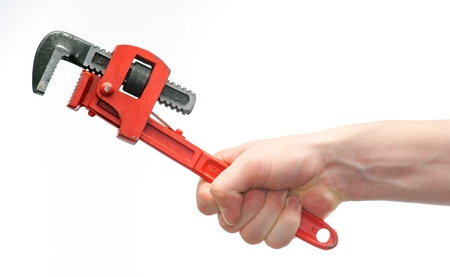 isolated caucasian young hand gripping a wrench