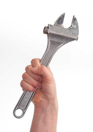 fix jaw: isolated caucasian young hand gripping a wrench
