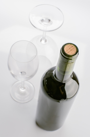 closed corks: unopened wine bottle and empty glasses