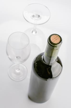 unopened: unopened wine bottle and empty glasses