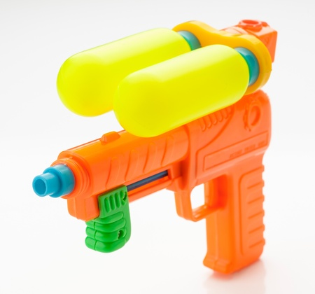 watergun: multicolor child water gun, isolated on white Stock Photo