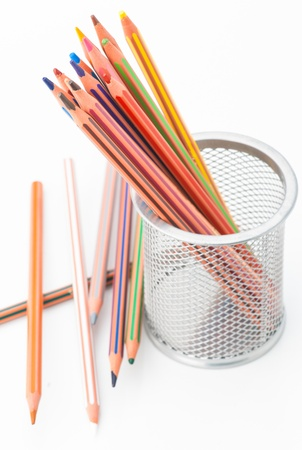 disordered: many pastel crayons, a bucket disordered