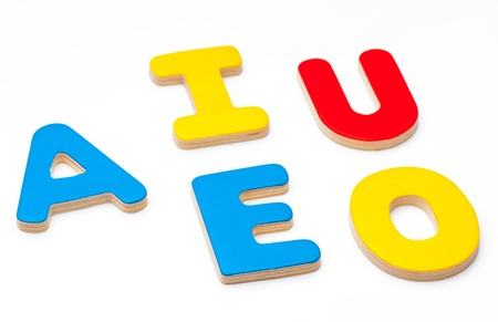AEIOU, the first five letters of the alphabet colored wood Stock Photo - 21892138