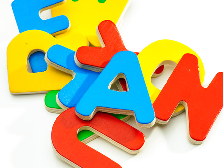 group of colored wooden letters jumbled Stock Photo