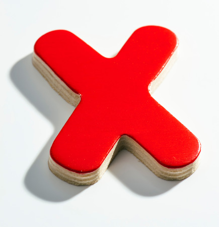 Shaded wooden red X on white base Stock Photo