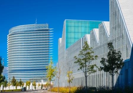 modern office buildings glisten in the sun in a European city Stock Photo