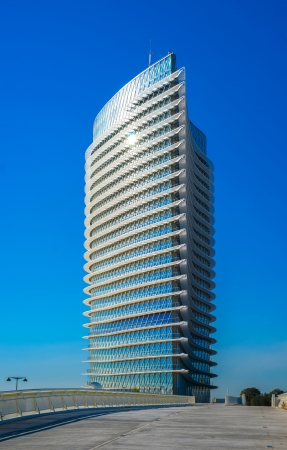modern office tower shines in the sun in a European city Stock Photo