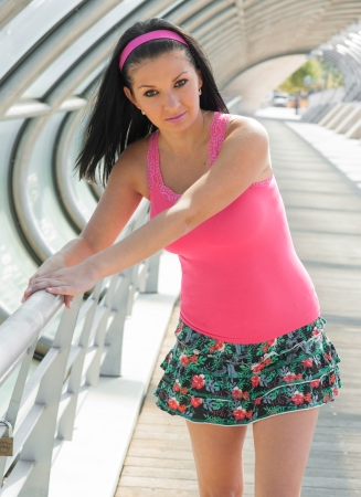 beautiful young girl in a miniskirt skater Stock Photo