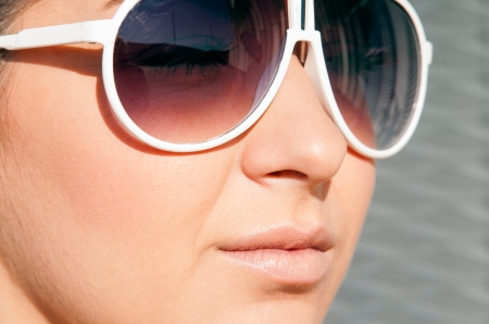 lips and nose of young woman with sun glasses