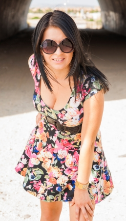 attractive young woman with short dress with flowers in the sun