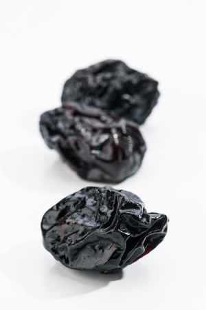 group of prunes on white base photo