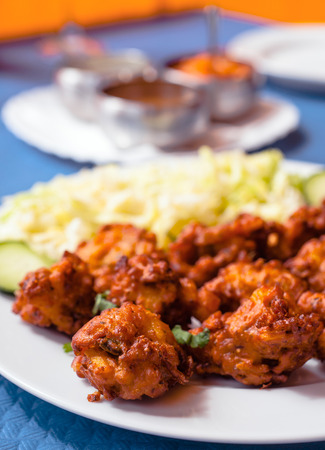 onion bhaji: pakora, breaded vegetables typical of Indian