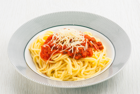 shredded cheese: spaghetty dish with tomato and shredded cheese