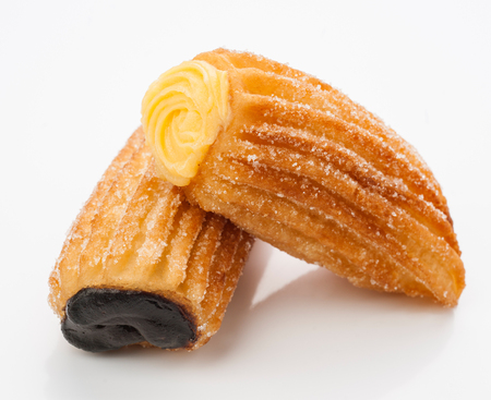 Cream Filled Churros and chocolate isolated on white Stok Fotoğraf