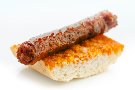 grease: Spanish sausage fried in its grease on bread Stock Photo