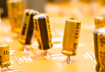 Capacitors: electrical capacitors on motherboard Stock Photo