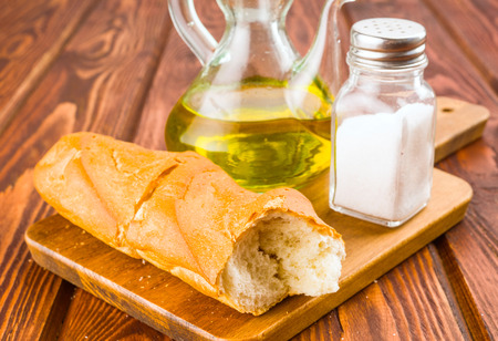macerated: Spanish bread with oil and salt on wooden board isolated on wooden