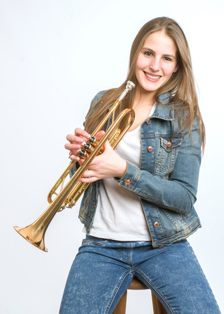 music background: young woman with her trumpet on white background