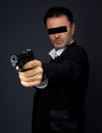 criminal: Gunman costume, police or criminal Stock Photo