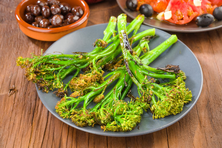 dish with tender shoots of broccoli grilled
