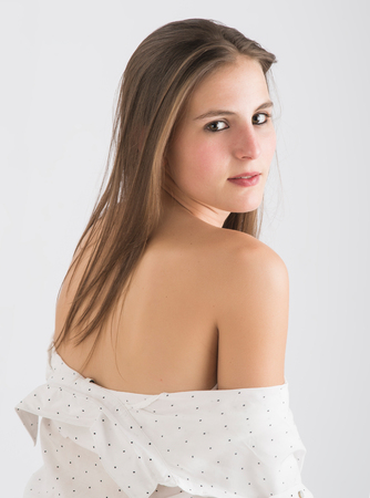 girl undressing: girl with unbuttoned shirt posing in studio Stock Photo