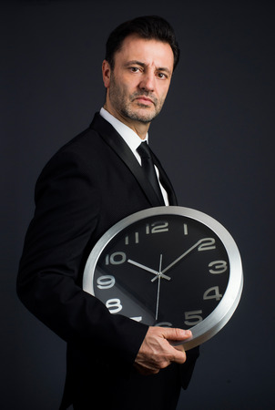 dressed: dressed man in studio with kitchen timer