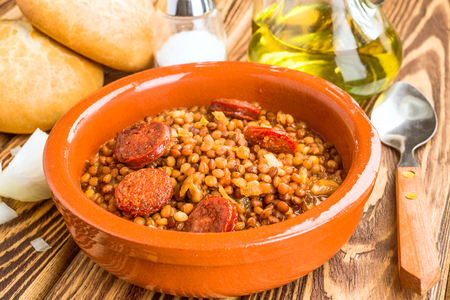earthenware dish with homemade lentil stew with chorizo Stok Fotoğraf