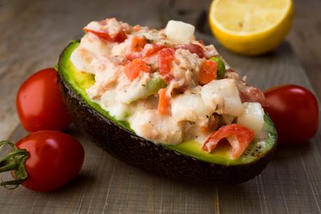 tuna mayo: cut avocado Russian salad stuffed in rustic charm