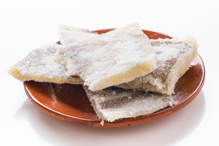 det: pieces of salted cod on clay plate isolated on white