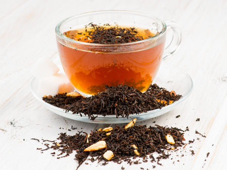 infusion: infusion of black tea pakistan in cup on wooden base