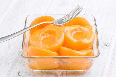 retained: means peaches in syrup in glass bowl