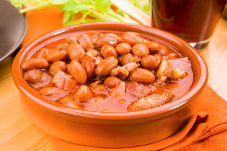 clay pot: homemade beans in a clay pot, on wood Stock Photo