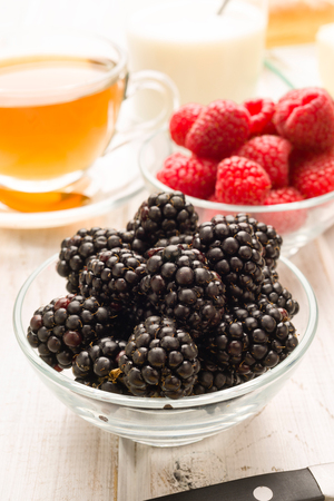 breackfast: blackberries and blueberries at the breakfast table Stock Photo